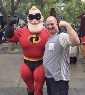 man posing with superhero character